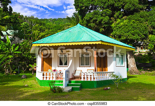 Bungalow in hotel at tropical beach - csp8355983