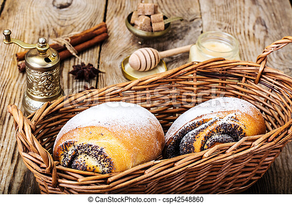 Buns with poppy seeds in a bread basket - csp42548860