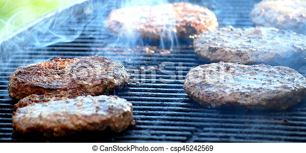 Burgers on grill. - csp45242569