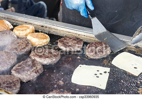 Burgers on grill - csp33960935