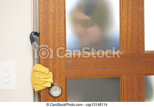Burglar breaking in house with crowbar - csp13148114