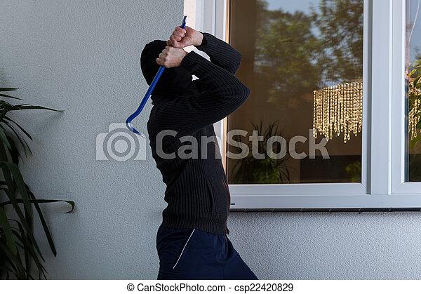 Burglar breaks the window - csp22420829