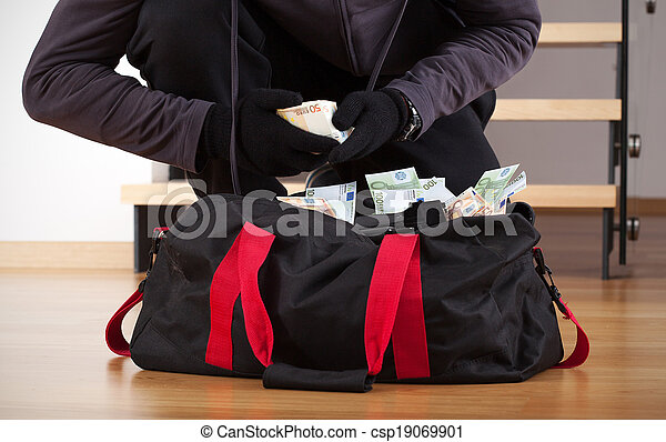 Burglar counting the money - csp19069901
