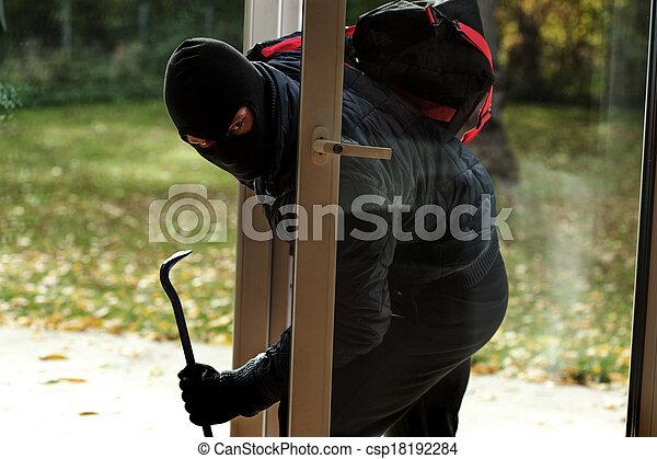 Burglar entering to house - csp18192284