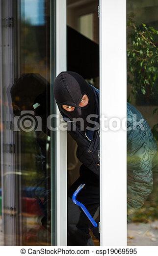 Burglar leaning out - csp19069595