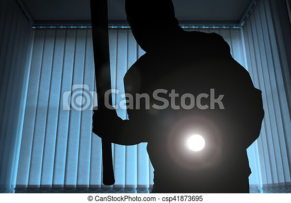 Burglar or intruder at night - csp41873695