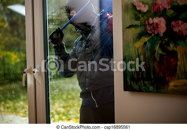 Burglar trying to open the window - csp16895561