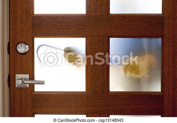 Burglar with crowbar at house door  - csp13148043