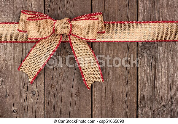 burlap christmas bow and ribbon top border on wood csp51665090 - Burlap Christmas Ribbon
