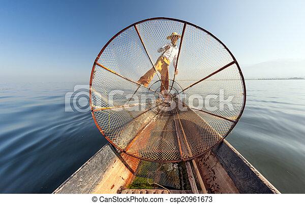 Burma Myanmar Inle lake fisherman on boat catching fish - csp20961673