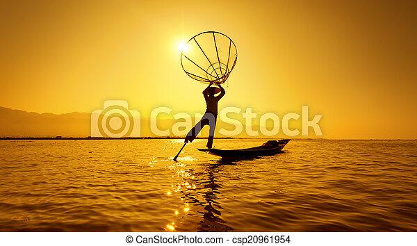 Burma Myanmar Inle lake fisherman on boat catching fish - csp20961954