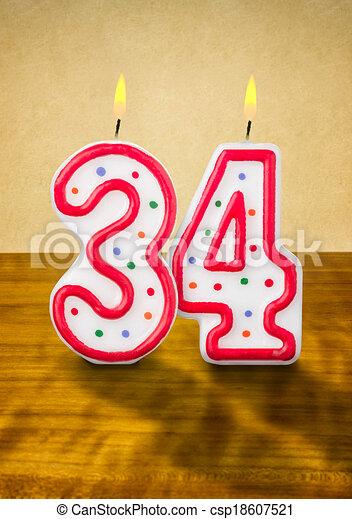 Burning birthday candles number 34 - csp18607521