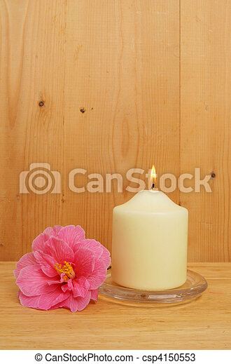 Burning candle and camellia flower - csp4150553