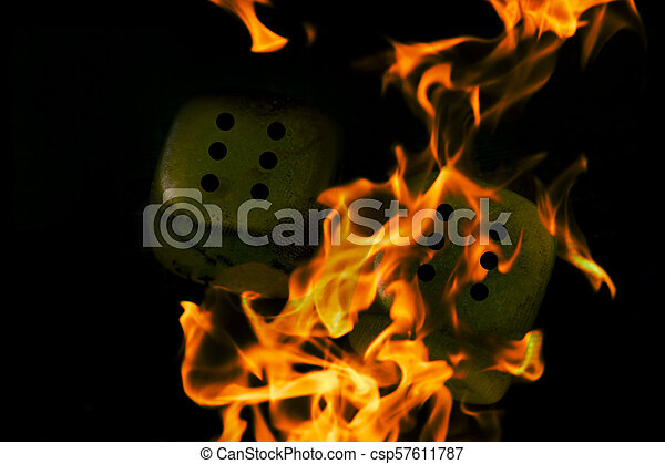 Burning cubes. dice in the fire - csp57611787