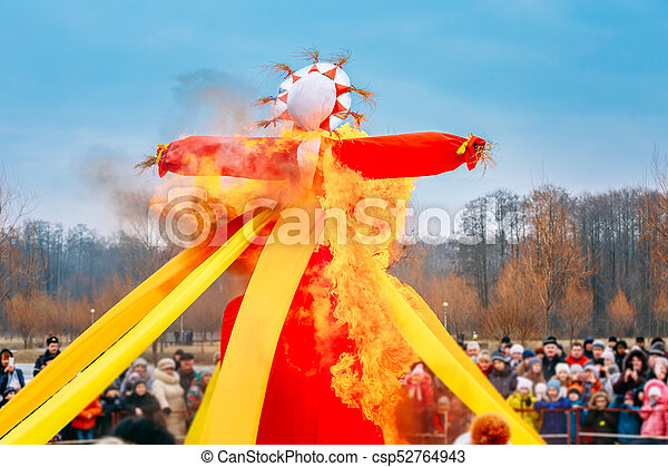 Burning Effigies Straw Maslenitsa In Fire On The Traditional National Holiday Dedicated To The Approach Of Spring - Slavic Celebration Shrovetide. - csp52764943