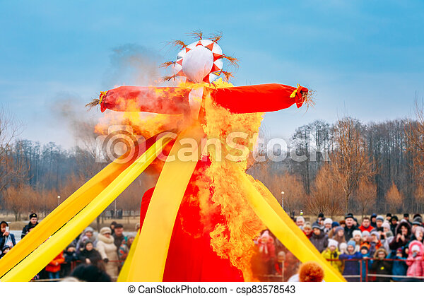 Burning Effigies Straw Maslenitsa In Fire On The Traditional National Holiday Dedicated To The Approach Of Spring - Slavic Celebration Shrovetide - csp83578543