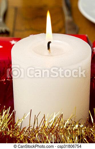 Burning festive candle - csp31806754