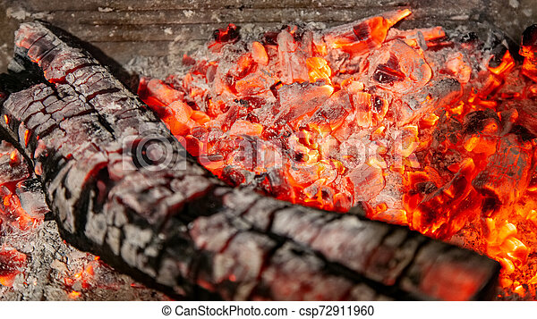 Burning log of wood close-up as abstract background. - csp72911960