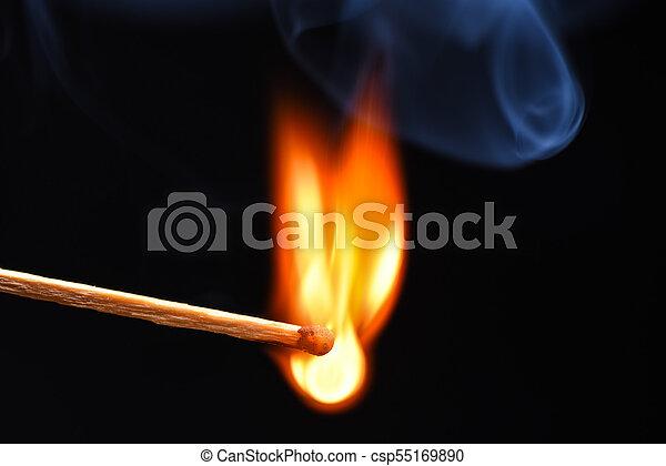 Burning match on a black background - csp55169890