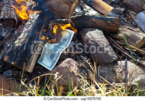 Burning money dollars - csp15978765