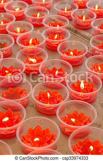 Burning red flower candle at chinese shrine for making merit in chinese new  year festival  Pray for New Year,Lighting incense to Buddha
