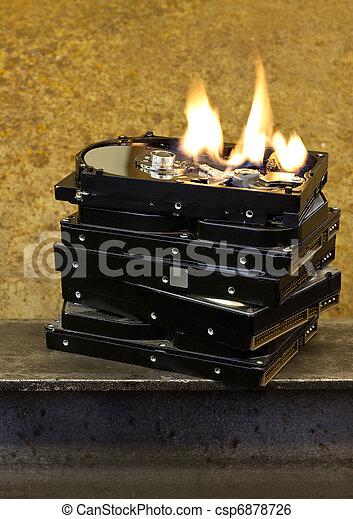 burning stack of hard drives - csp6878726