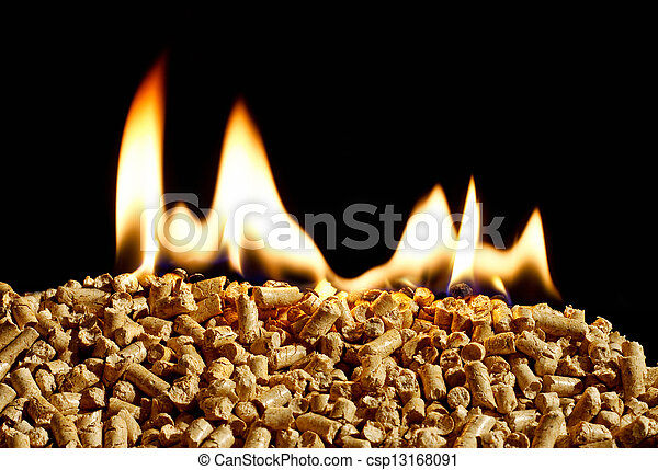 burning wood chip pellets a renewable source of energy becoming popular as a green environmentally friendly fuel for stoves which provide household heating - csp13168091