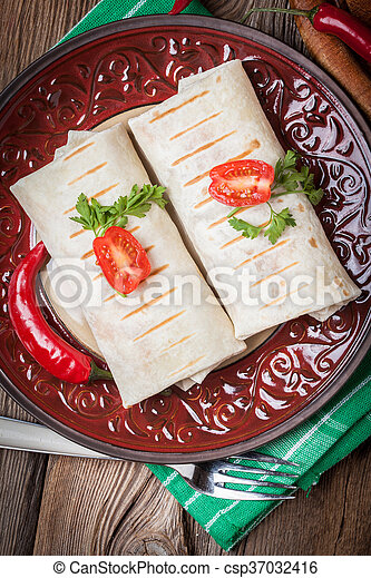 Burritos filled wiht minced meat, bean and vegetables. - csp37032416