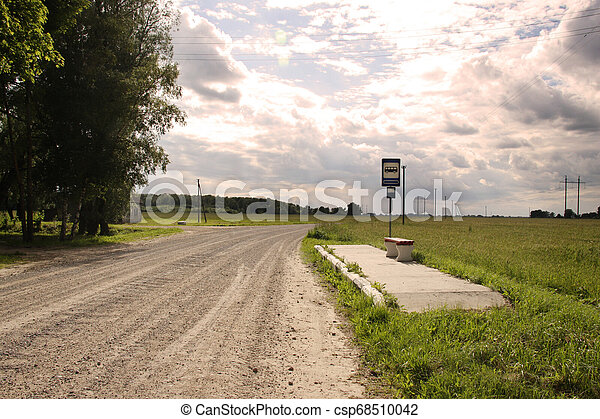 Bus stop in Lithuania village gravel road - csp68510042