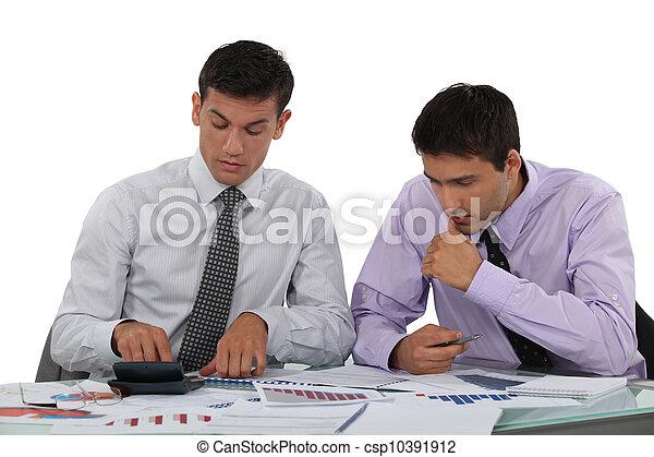 Business associates undertaking market research - csp10391912