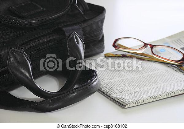 business bag and newspaper - csp8168102