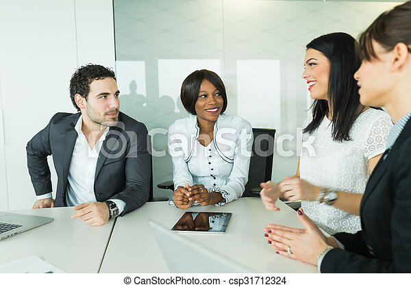 Business brainstorming and exchange of ideas by nicely dressed people - csp31712324