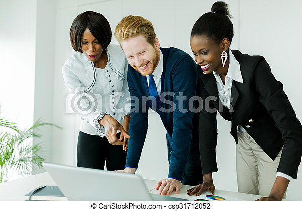 Business brainstorming by happy, nicely dressed multi-ethnic people - csp31712052