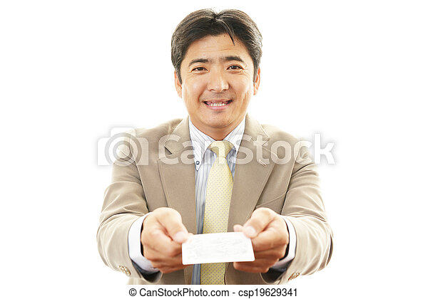 Business card exchange the male office worker who poses happily business card exchange csp19629341 reheart Image collections