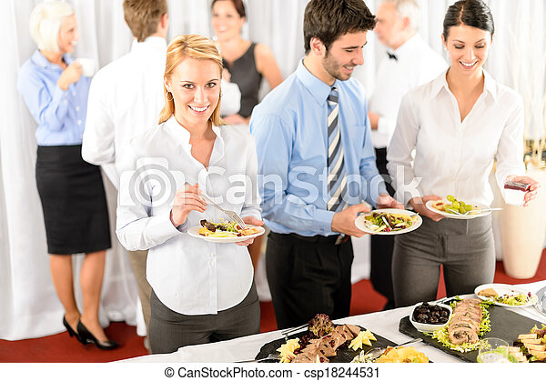 Business colleagues serve themselves at buffet - csp18244531