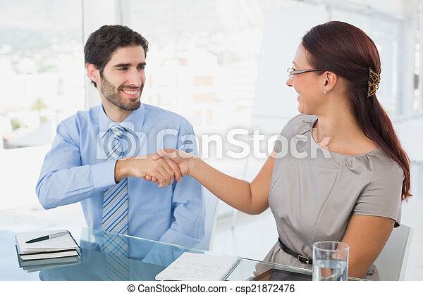 Business colleagues shaking hands - csp21872476