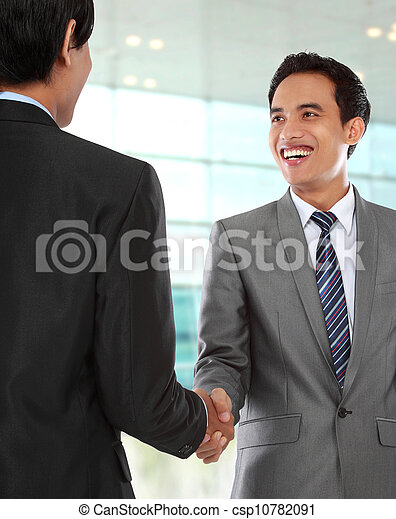 business colleagues shaking hands - csp10782091