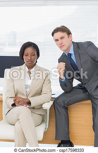 Business colleagues sitting in office - csp17598333