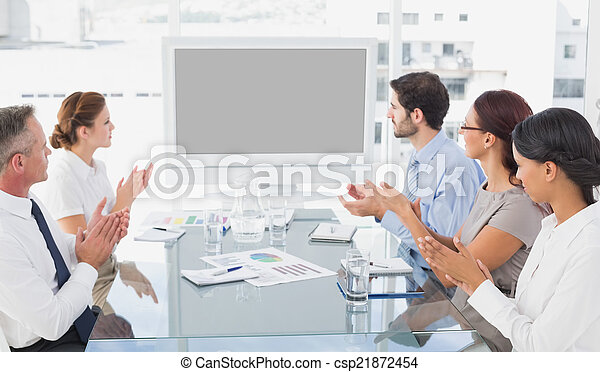 Business colleagues watching video  - csp21872454