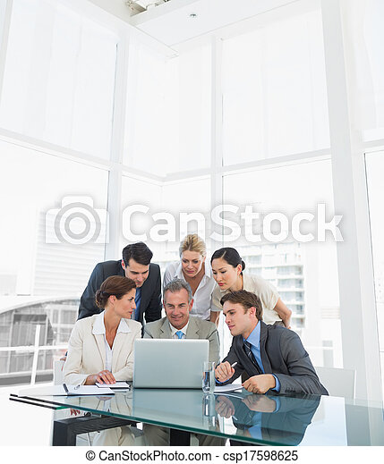 Business colleagues with laptop at  - csp17598625