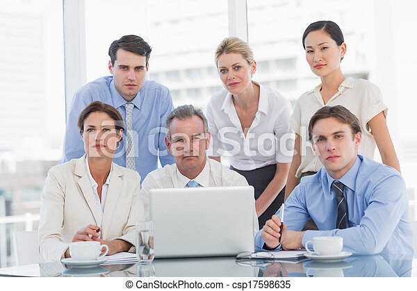 Business colleagues with laptop at  - csp17598635