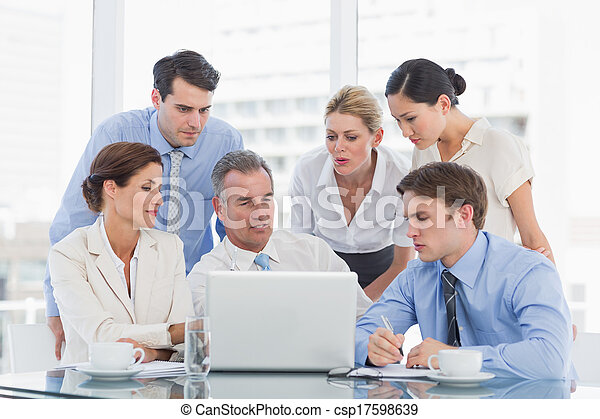 Business colleagues with laptop at  - csp17598639