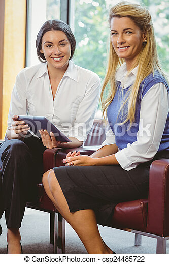 Business colleagues with tablet  - csp24485722