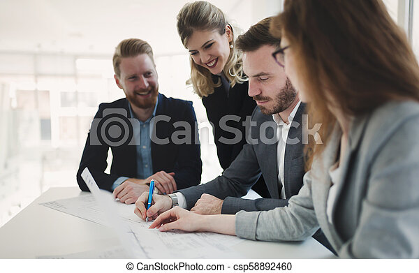 Business colleagues working in office - csp58892460