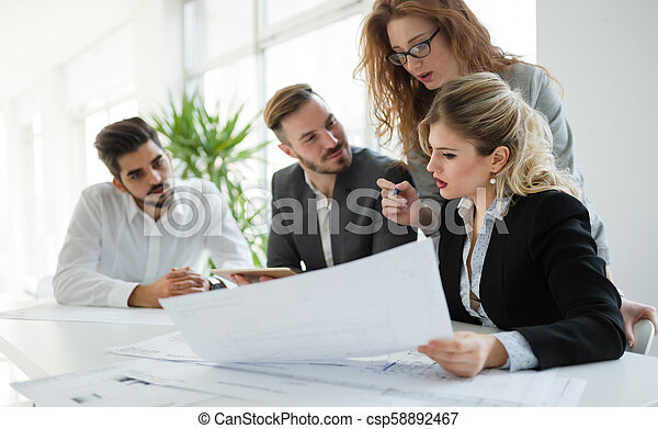 Business colleagues working in office - csp58892467