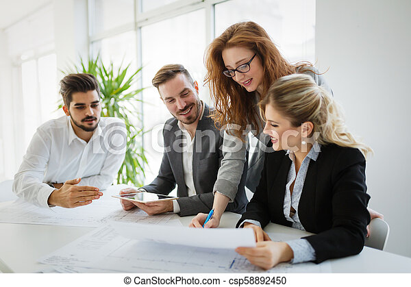 Business colleagues working in office - csp58892450