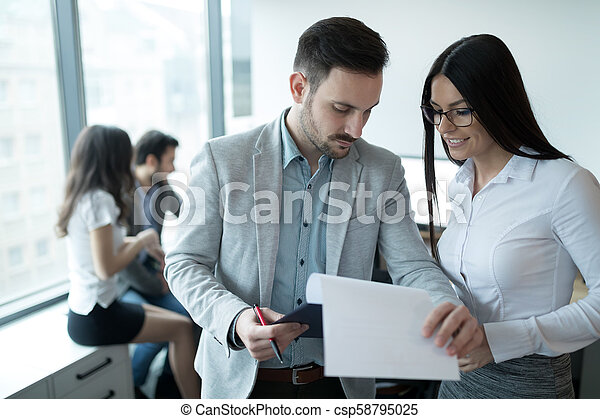 Business colleagues working in office - csp58795025