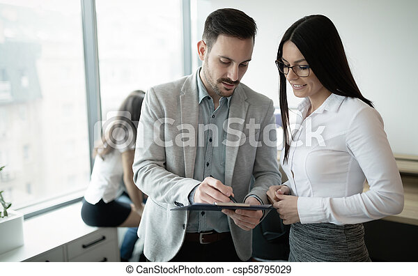 Business colleagues working in office - csp58795029
