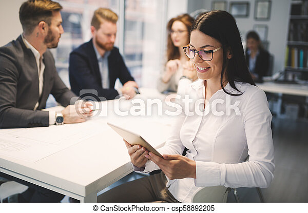 Business colleagues working in office - csp58892205