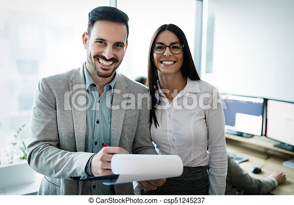 Business colleagues working in office - csp51245237
